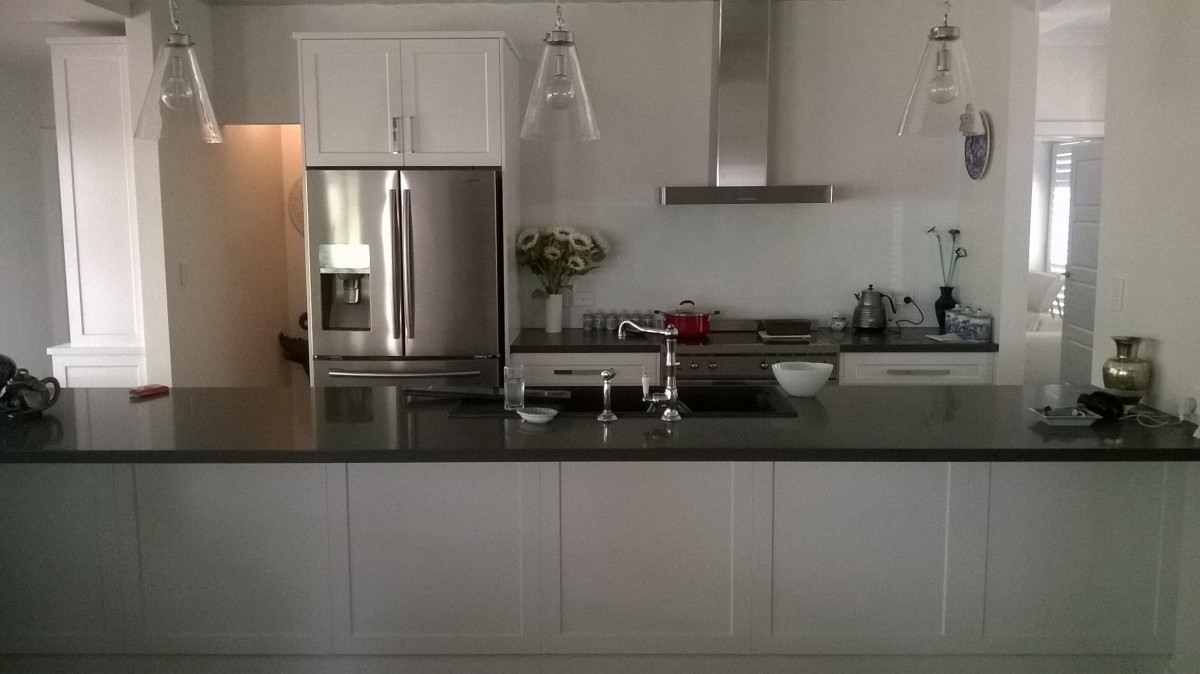 White Laminate Kitchen With Black Stone Benchtop Stirling